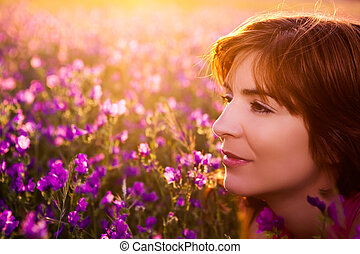 Enjoy the nature - Beautiful young woman portrait on a...