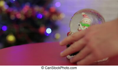 Snowglobe with snowman on the Christmas tree