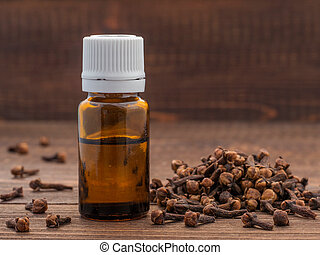 Spice clove essential oil in dark glass bottle anddry cloves...