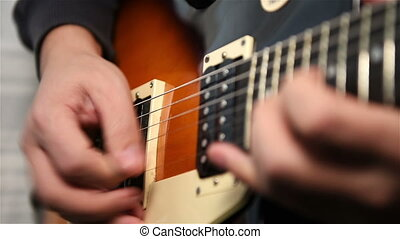 Guitarist Plays Rock Music - Musician Plays Rock Music On...