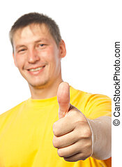 Smiling young man giving a thumbs up sign
