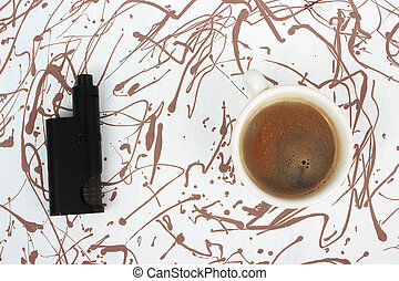 Vaping set and coffee on art painted cackground. Creative...