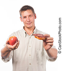 Young man with red apple and sandwich