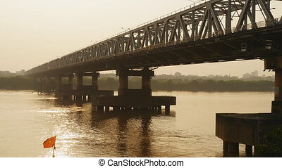 Chuong Duong Bridge in Hanoi On the Sunset. Vietnam. -...