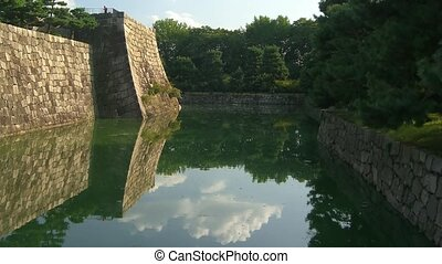 Time lapse moat of Osaka Castle - Time lapse clouds over...