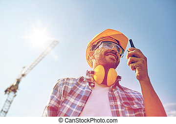 builder in hardhat with walkie talkie - industry, building,...