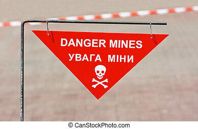 Warning sign on mined area in the city street