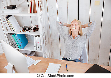 Business woman resting while sitting on chair at her...