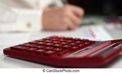 Businessman Calculate Income - Businessman On The Calculator...