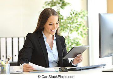 Businesswoman working on line with a tablet