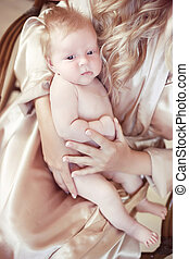 closeup portrait of baby lying on mother hand. mom and child...