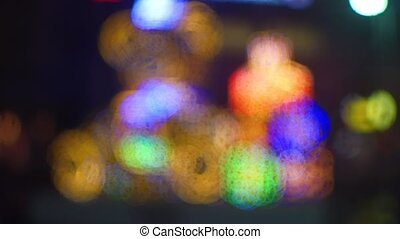 Christmas light street decoration bokeh circles at night. 4K...