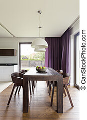 Wooden table in modern room - Dark wooden table and a set of...