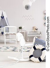 Room with rocking horse and cradle - Part of baby room with...