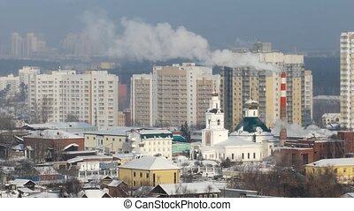 Smoke from the pipes against the backdrop of the city. Ekaterinburg