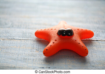 Starfish Toy on Wooden Background