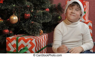 Little boy thinks up the letter to the Santa Claus