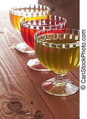 colored jelly in a bowl on a wooden table
