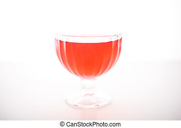 colored jelly in a bowl on a white background
