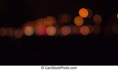 Street traffic bokeh circles at night. Cars passing by. 4K...