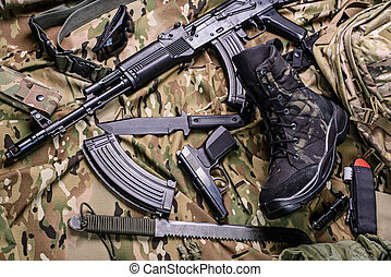 Army boot and different weapon - Military boot, gun, knife,...