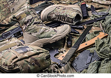 Pair of military boots, machete,ax,pistol and other military...