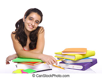 young girl sitting in front of her books