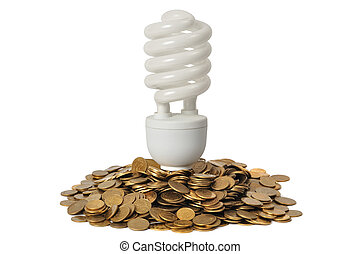 Energy Saving - Energy saving light bulb and stacks of coins...