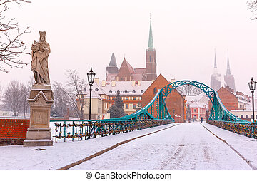 Tumski Bridge in snowy winter day, Wroclaw, Poland - Tumski...