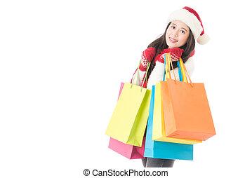 Christmas shopping woman with gift bag joyful