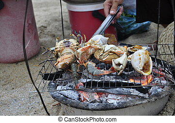 Barbecued Shellfish - Various shellfish on the grill at the...
