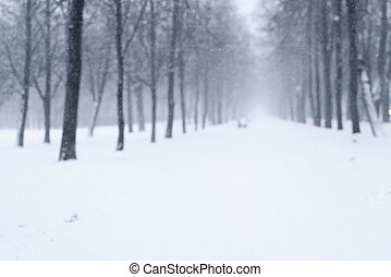 blurred background of snowfall in the morning on town alley,...