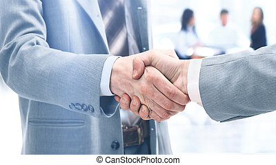 businessmen shaking hands after signing a lucrative...