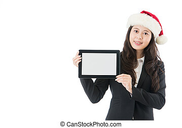 business woman holding digital tablet in santa hat