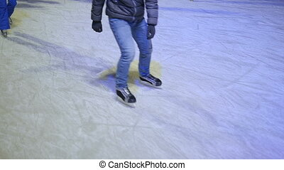 People skate on the rink skating winter. Slow motion -...