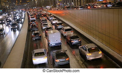 Timelapse. Rapid movement of cars on city streets. In evening time.