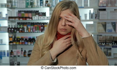 Woman comes to the drugstore with sore throat - Young...