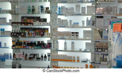 Male customer chooses some medicine at the drugstore -...