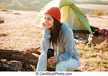Young woman near the tent