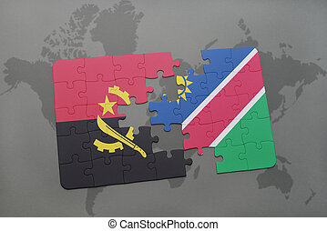 puzzle with the national flag of angola and namibia on a...
