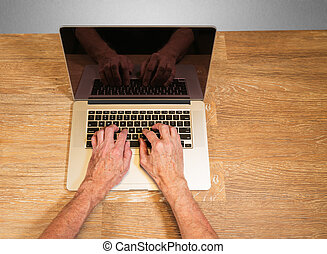 Senior adult man touch types on laptop - Senior caucasian...