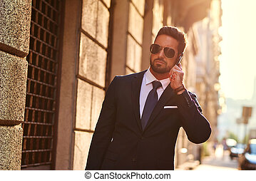 Young businessman on the street - A handsome young...