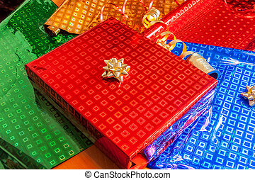 Gift wrapped in red paper with golden bow