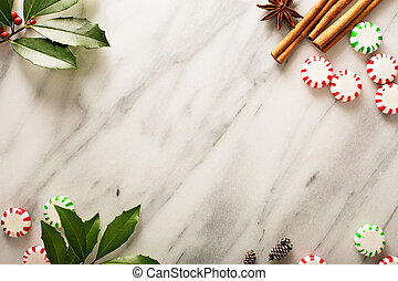 Holiday background with peppermint candy and spices on...