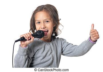 Girl singing karaoke - Portrait of little girl singing...