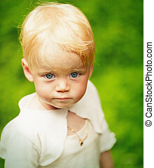 One year girl - One year blond girl outdoors portrait...