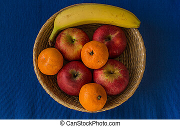 Wooden basket filled with healthy and fresh fruits
