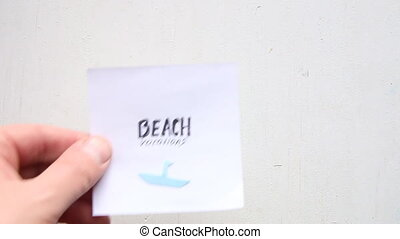 Beach vacation concept - Beach vacation idea, hand and a...