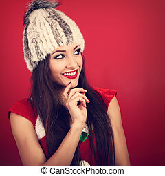 Happy toothy smiling thinking makeup woman in white fur...