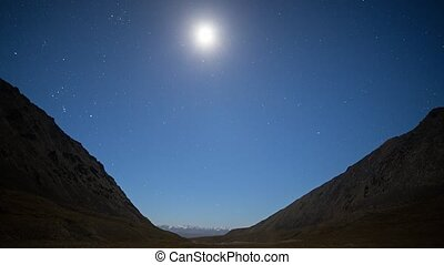 Night - Dawn in the mountains. Moon. Plateau Kara-Say (3.800...